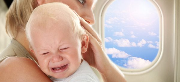 What should I do if my child cries during a flight?